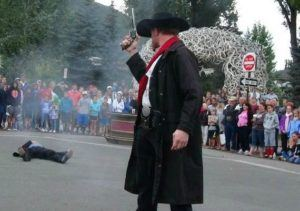 Photo of the famous Jackson Hole Town Square Shootout in action